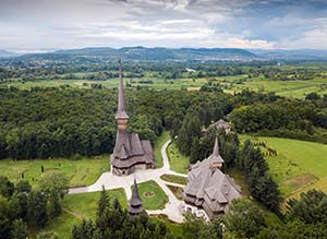 Traditional Maramures neo-gothic wooden church in Sapanta-Peri monastery with highest wooden belltower in Europe, Romania